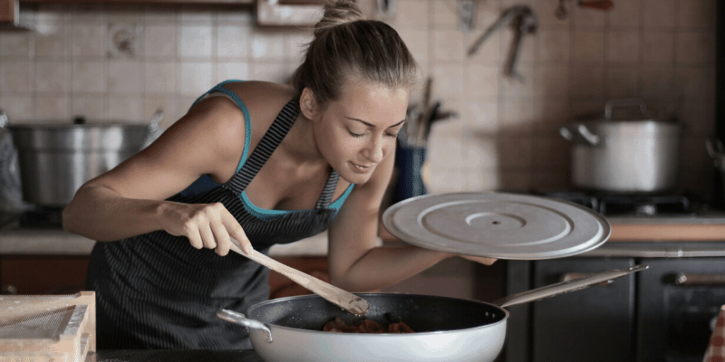 Why induction cooktops sometimes smells like it's burning